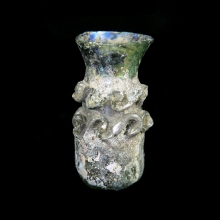 Islamic glass bottle with trail decoration and flared spout