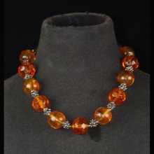 A necklace comprising faceted amber beads and vintage silver spacer beads.
