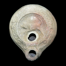 Roman pottery oil-lamp with central Bull figure in relief