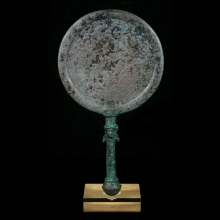 A fine and important Bactrian bronze mirror with figurative handle