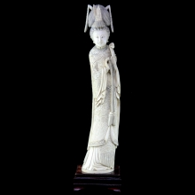 A late Qing carved ivory standing figure of an Empress