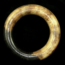 Neolithic mottled brown and cream coloured jade bracelet.