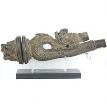 An Indonesian Batak hard wood stopper for a Shaman magic horn, carved in