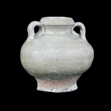 A Thai Sawankhalok celadon glazed double handled ceramic vase