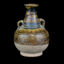 A Thai Sawankhalok brown glazed ceramic double lugged flask