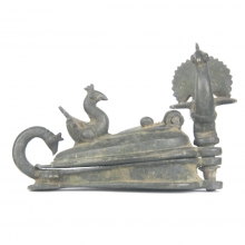 An Indian bronze cosmetic container with peacock finials
