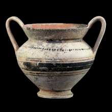 A Hellenistic pottery Krateriskos with painted linear and dot designs in red and black pigments.