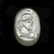 A Sassanian rock crystal stamp seal the surface engraved with an image nobleman in profile.