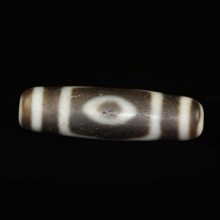 Tibetan three eye Dzi bead.