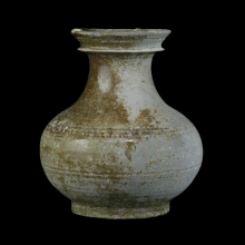 A Han Dynasty deep olive green glazed pottery vessel