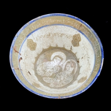A Kashan lustre bowl with two central figures and script around the inner walls
