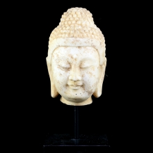 A Ming to Qing marble head of Buddha