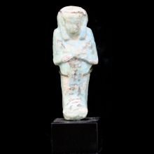 Egyptian azure glazed faience Ushabti with details and hieroglyphs in a black glaze.