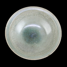 A Thai Sawankhalok celadon glazed deep ceramic bowl
