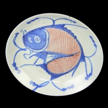 A Qing celadon blue and red fish plate
