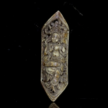 A Tibetan tantric bone plaque carved with tantric a Dakini figure on the front surface.