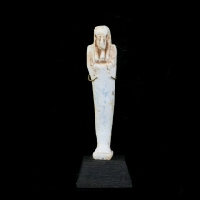 An Egyptian pale green glazed faience Ushabti