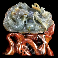 A fine Chinese agate carving depicting a dragon and phoenix