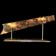 An early Shang mottled brown jade ceremonial axe blade