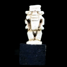 Egyptian white faience amulet of the dwarf god Bes