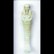 A fine Egyptian faience ushabti with a horizontal band of hieroglyphic text on the front surface.