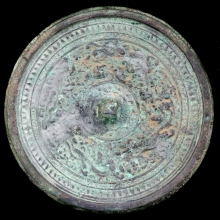 Eastern Han bronze mirror the ornate surface depicting a Qilin amongst clouds