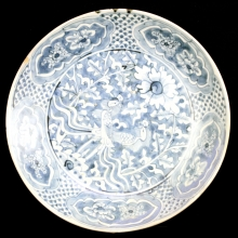 Chinese Swatow ware blue and white charger with phoenix and floral decoration.