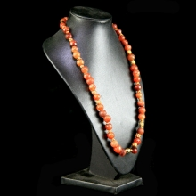 A Chinese neckalce comprising Ming Dynasty carnelian round beads and late Qing Dynasty gilt spacer beads.