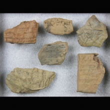 Clay fragments from Mesopotamia with cuneiform inscription and figurative sealing.