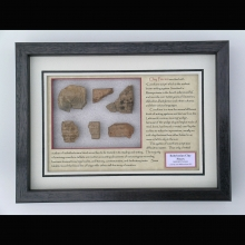 Clay fragments from Mesopotamia with cuneiform inscription and sealing.
