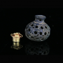 Gandharan silver poppy vessel with opernwork carved walls, and 22 Ct gold stpopper