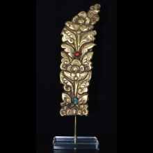 Tibetan gilded bronze repousse fragment with inlay