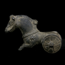 An important Indo-Greek silver wheeled toy in the form of a galloping horse.