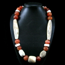 A Mongolian fossilized shell and carnelian bead necklace