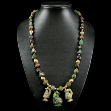 A fine Persian and Roman-Egyptian glass bead necklace with modern gold beads