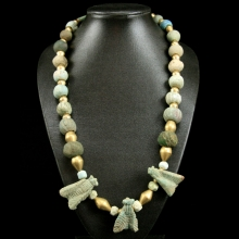 A necklace comprising Middle Kingdom faïence beads, with three Royal faience bee amulets and modern gold spacer beads