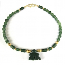A Mongolian green jade bead necklace with central stylised human figure pendant.