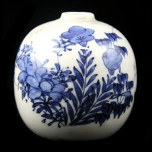 A late Qing blue and white rice wine bottle