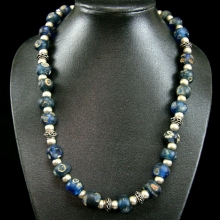 An old Islamic Fustat (Cairo) glass eye bead necklace with later Islamic silver bead spacers.