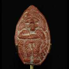 North Indian red clay amulet of a deity.