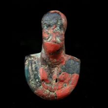 A Ptolemaic red and green glass amulet of Sekmet