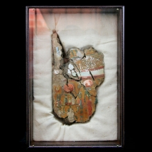 An Egyptian Nile mud linen and gesso painted Sarcophagus cartonnage fragment