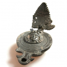 A rare Roman bronze oil lamp, the lid with an image of Mercury