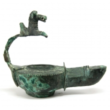 A late Roman to Byzantine  bronze oil lamp, the handle in the form of a prancing horse