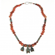 A Mongolian carnelian and bronze bead necklace, with modern sterling silver clasp.