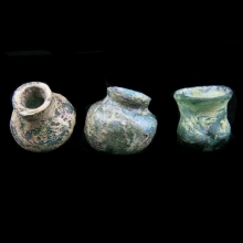 A group of three Roman glass unguent vessels