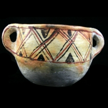 An Algerian painted pottery double-handled vessel